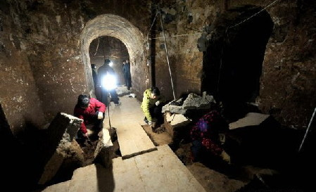 The file picture taken on Dec. 30, 2009 shows archaeologists clean up the archaeological site where the Mausoleum of Cao Cao is located in Anyang, a city in central China's Henan Province. The Mausoleum of Cao Cao, a legendary Chinese warlord during the Three Kingdoms period (208-280 A.D.), has recently been declared as Cultural Relics under Provincial Protection. The tomb is located near the Yellow River and the city of Anyang, where Cao Cao ruled the Kingdom of Wei from 208 to 220, when he died at the age of 65.