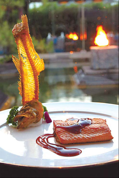 Flaky trout fillet served at Bai Yun, the Banyan Tree Lijiang, features fresh Lijiang trout.