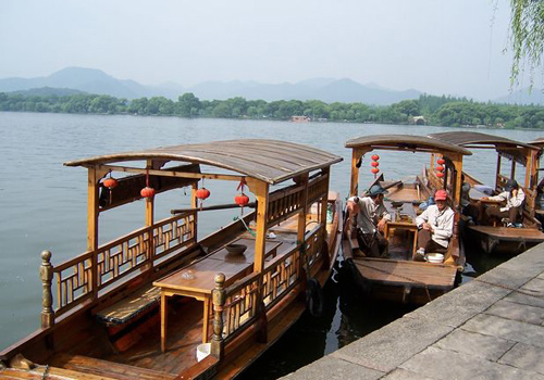 West Lake boat trip is very popular by tourists.
