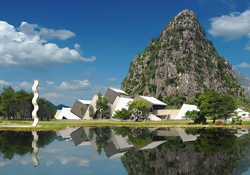 Artistic buildings located among picturesque natural landscapes in Yuzi Paradise,Guilin