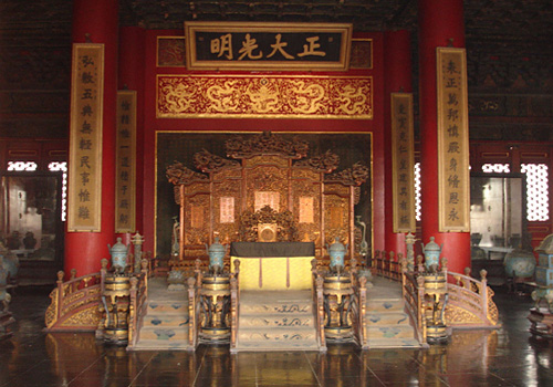 "The resplendent and magnificent Emperor Dragon Throne inside the Hall of Heavenly Purity, with """"Justice and Brightness"" in Chinese written on a plaque hanging above."