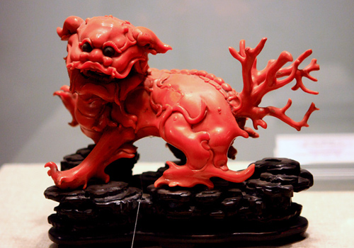 A precious handicraft carved from red coral is collected in the Forbidden City.