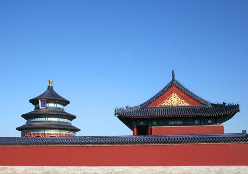 The Temple of Heaven, the red wall and one of its side halls look vivid by contrast with blue sky.