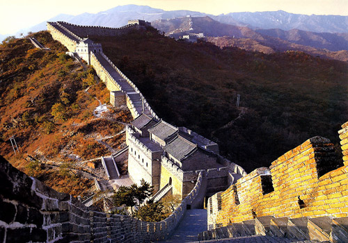 The Mutianyu Great Wall is surrounded with golden plants in autumn.