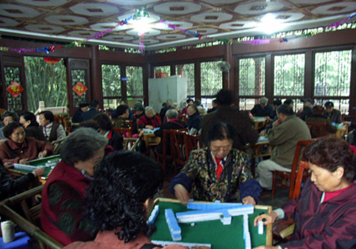 People playing mahjong everyday in the open to public area in the Wangjiang lou Park