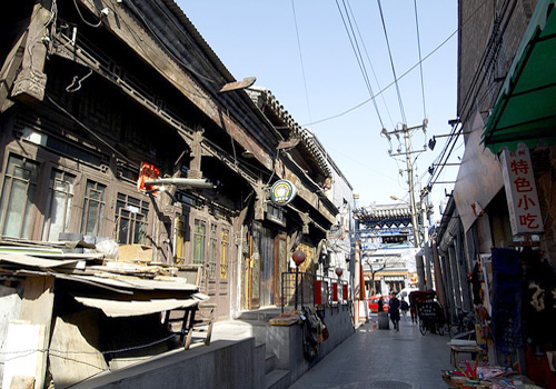 One old Hutong still keeps its original appearance in spite of the many towering buildings in Beijing.
