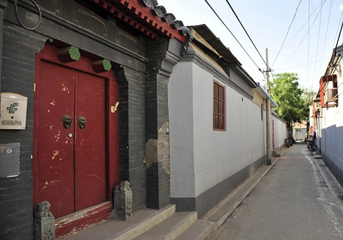 Traditional doors in Beijing Hutongs are commonly painted red with lion-head-shaped door knobs.