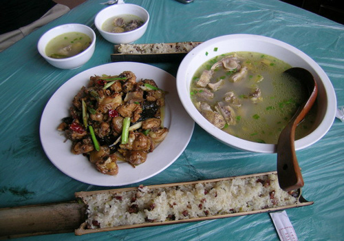 Local chicken soup, fried chicken with chillis and rice cooked inside bamboo tube are featured food in the local villages in the Dragon's Backbone Rice Terraces, Longsheng, Guilin.