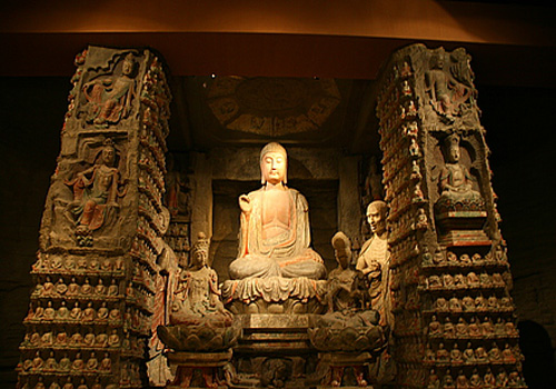 A corner in the Exhibition Hall No.3 of Shaanxi History Museum displays figures of Buddhas.