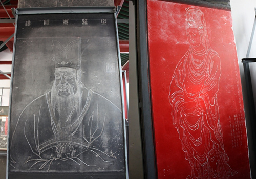 Stone portraits of Confucius and Avalokitesvara displayed at the Exhibition Hall No.4,Forest of Stele Museum of Xi'an,Shaanxi Province.