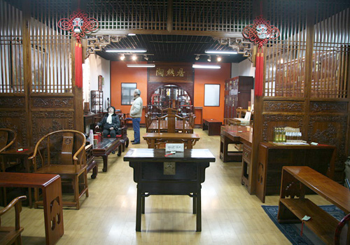 Traditional furniture are sold in Panjiayuan.