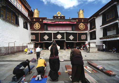 Kowtowing in front of Jokhang Temple is still a religionary tradition of the pious worshipers.
