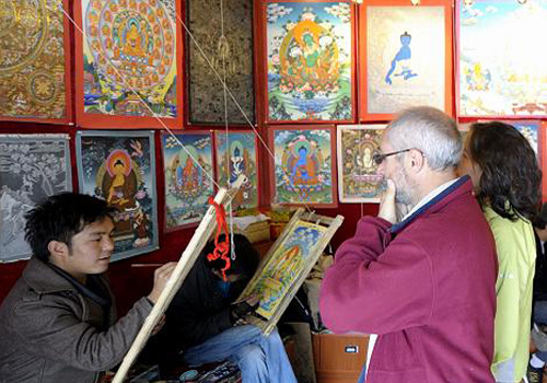Tourists are visiting the making of Thangka in a shop at Barkhor Street of Lhasa.