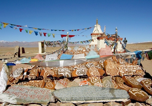 Religious prayer stones and flags at the lakeshore,Tibet