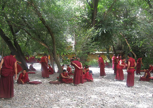 Lamas of Drepung Monastery are debating sutras.