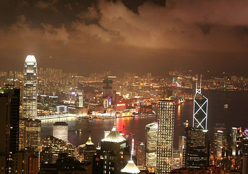 Brightly-lit city landscape of the Central from the top of Victoria Peak, Hong Kong.