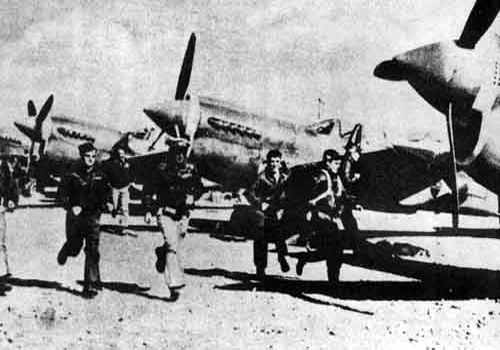 An old picture of the Flying Tigers and the P 40 fighter planes.