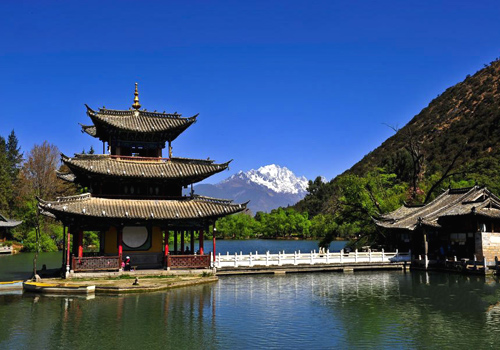 The peaceful view of the Black Dragon Lake in Lijiang Ancient town under the clear sky.