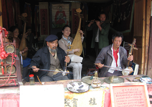 Villagers of Baisha Ancient Village are playing traditional Chinese musical instruments.