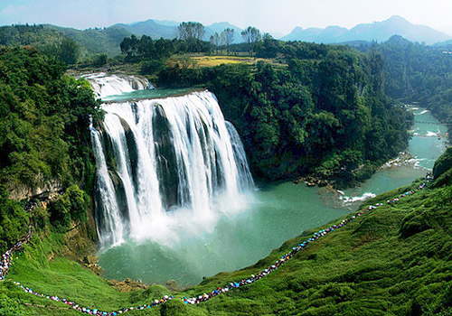 The grand Huangguoshu Waterfall is 67 meters high and 83.3 meters wide.