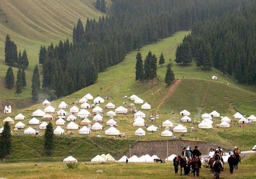 The local and their white yurts in the South Pastrue orNanshan Scenic Area in Urumqi.