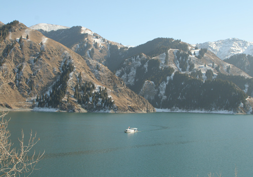 A toruist yacht is sailing on the Heavenly Lake,Urumqi attractions,Xinjiang.