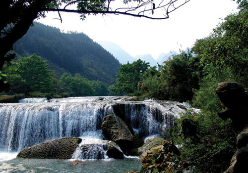 Jiuxiang Scenic Area is a tourist attraction endowed with green valleies,caves,and waterfalls.