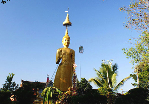 Buddha statue to the south of White Stupas in Xishuangbanna