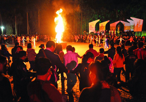 The famous Dancing Singing Fire Evening Party of the Lancang-Mekong River in Manting Park