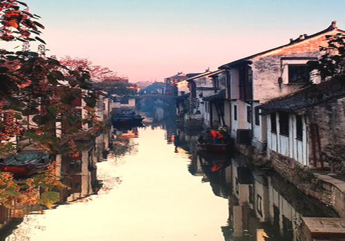 "Zhouzhuang enjoys the good reputation as ""the first water town in China""."