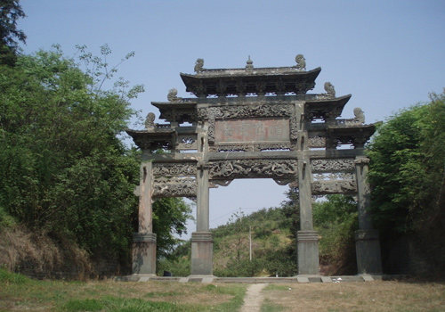"Xuanyue Gate is 20 metres high, 12.81 metres wide with the four characters ""治世玄岳"" written on the memorial archway by Jiajing Emperor."