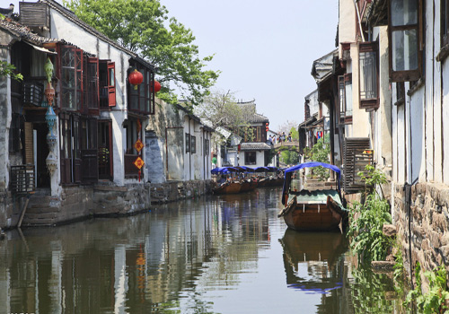 "Zhouzhuang enjoys its good reputation as ""the first water town in China""."