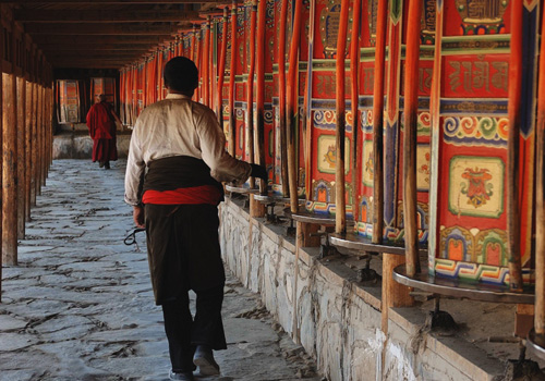 People moving the prayer wheels in Labrang Monastery in Xiahe,Gansu Province.