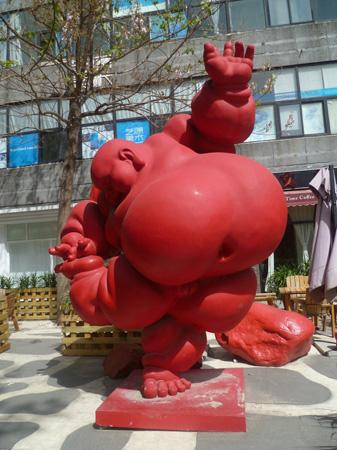 The red sculpture of fat man, Beijing 798 Art Zone