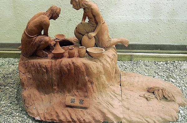 Sculpture of Ancient People Making Ceramics