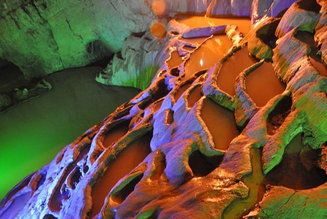 It is encompassed by karst caves, deep valleys, and Yi ethnic minority's cultural landscapes.