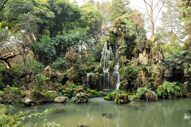 The delicate rockery and small waterfall in People's Park of Chengdu