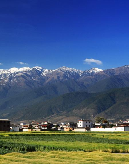 A charming poetic view of Dali with the snow capped Mount Cangshan.