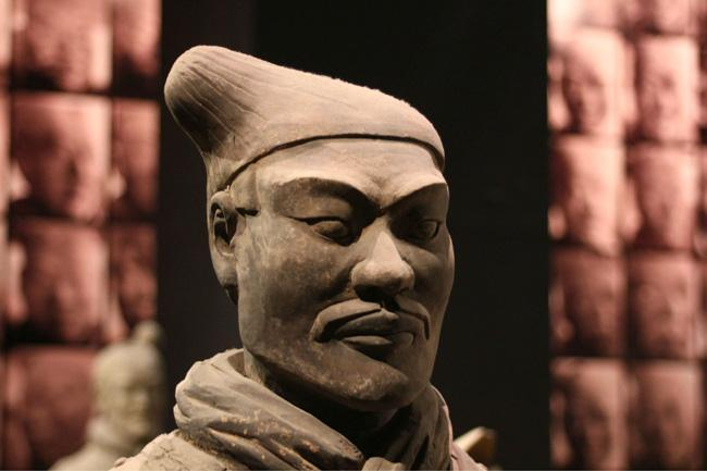 A soldier from the Terracotta Army and Horses exhibits in the museum, Xi'an