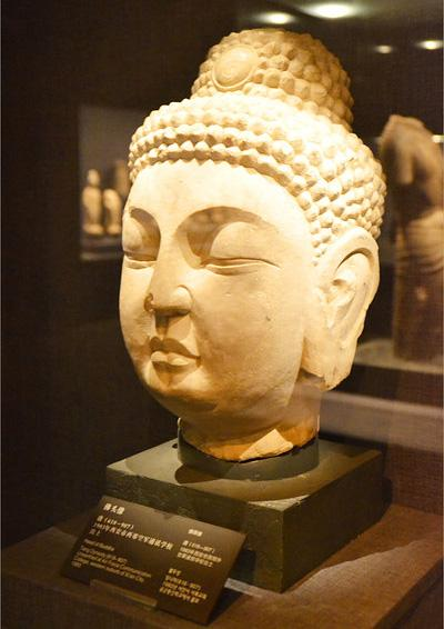 The Buddha head displayed in the Stone Carving Art Musuem of the Forest of Stele Museum, Xi'an