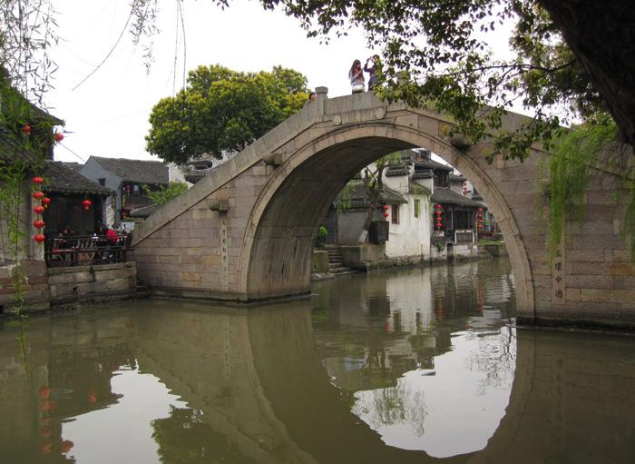 Xitang is romanticly connected by many a arch bridge.