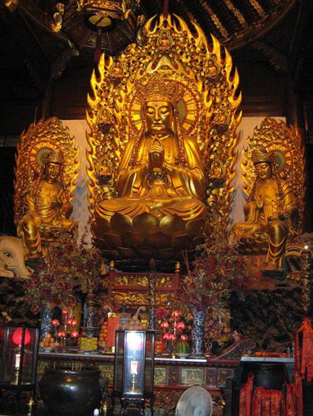 The golden Buddha enshrined in the hall in Longhua Temple, Shanghai