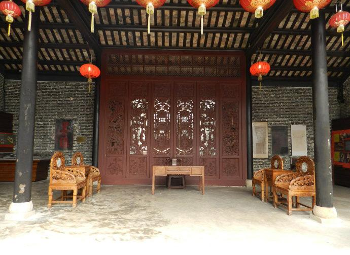 A interior scene of an ancient building in Kowloon Walled City Park.