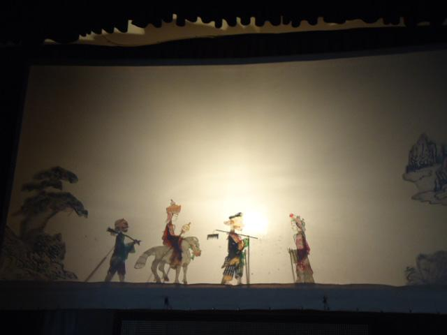 Shadow play showed in Gao Family's Courtyard in Huimin Street,Xi'an