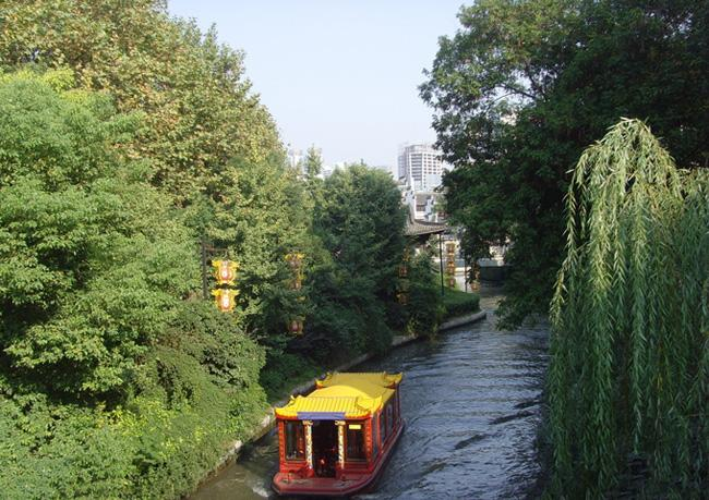 The narrow riverway and a sightseeing boat