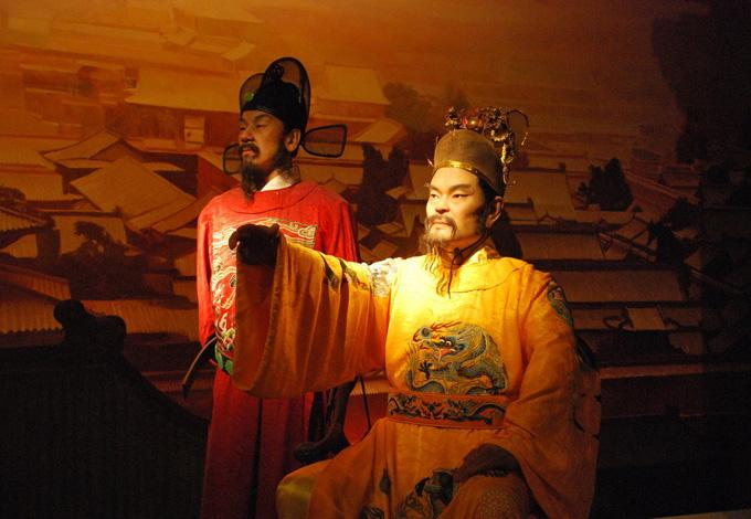 A wax statue of an anicnet emperor and his minister