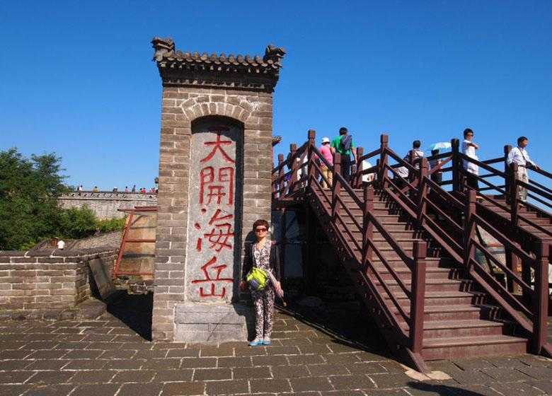 Tourists Take Photo in the Old Dragon Head Scenic Spot