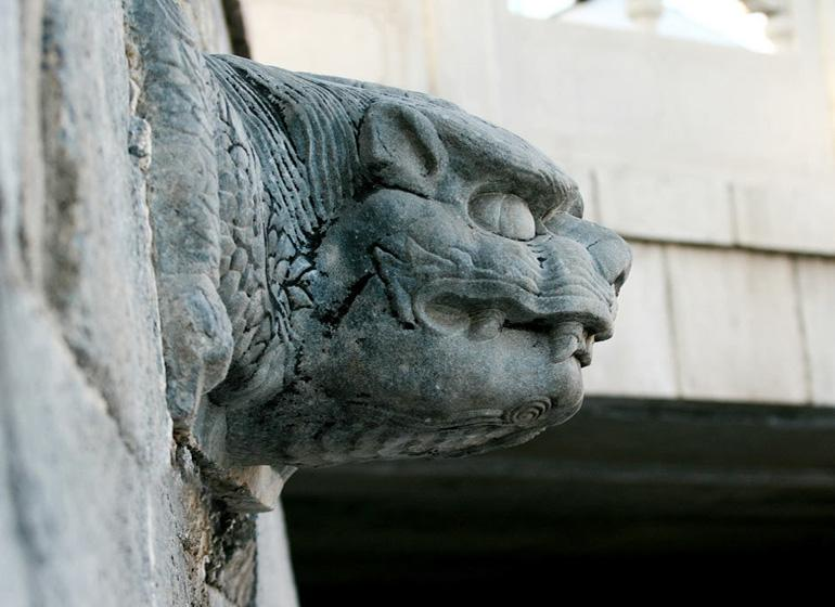 White-marble-carved Beast on Lock Wall of Guangyuan Water Gate in Beijing