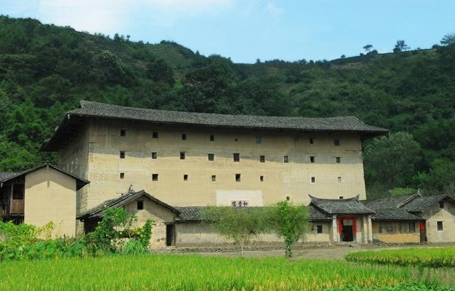 The building is surrounded by beautiful rural scenery.