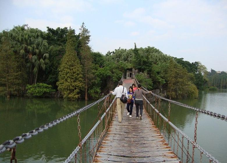 Suspension Bridge over the Lake in Zhaoqing Seven Stars Cave Scenic Park, China